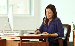Lady looking at paperwork and smiling