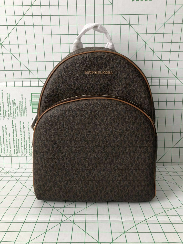 20b8c8d6eb0d Michael Kors Signature PVC Abbey Large Backpack in Brown acorn ...
