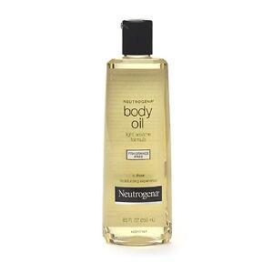 details about neutrogena body oil light sesame formula fragrance free. Black Bedroom Furniture Sets. Home Design Ideas