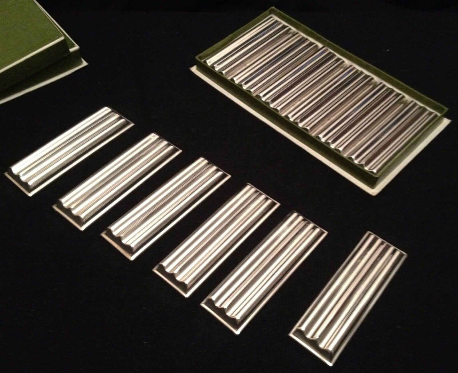 12 porte-couteaux en métal Silberé modèle  ondulations  Christofle