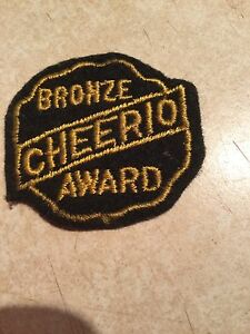 "Cheerio Bronze Award Yo Yo Patch. 2"" by 1 3/4"". 1950's"
