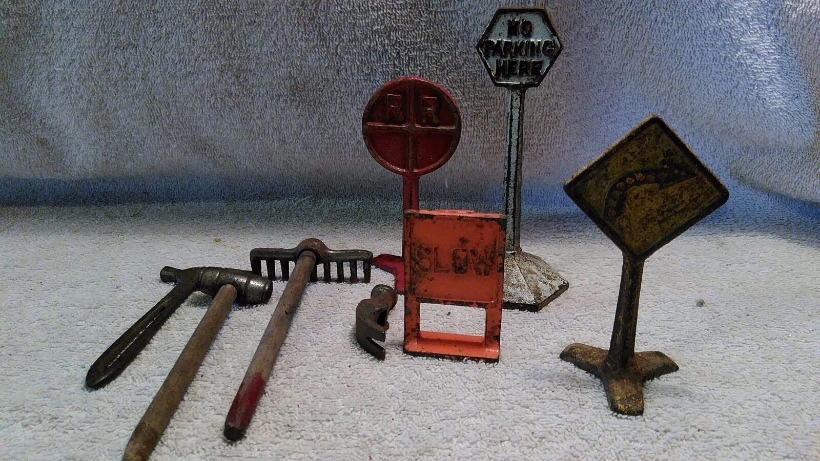 1937 Cast iron Arcade Road Construction Set: RR crossing etc  . And tools