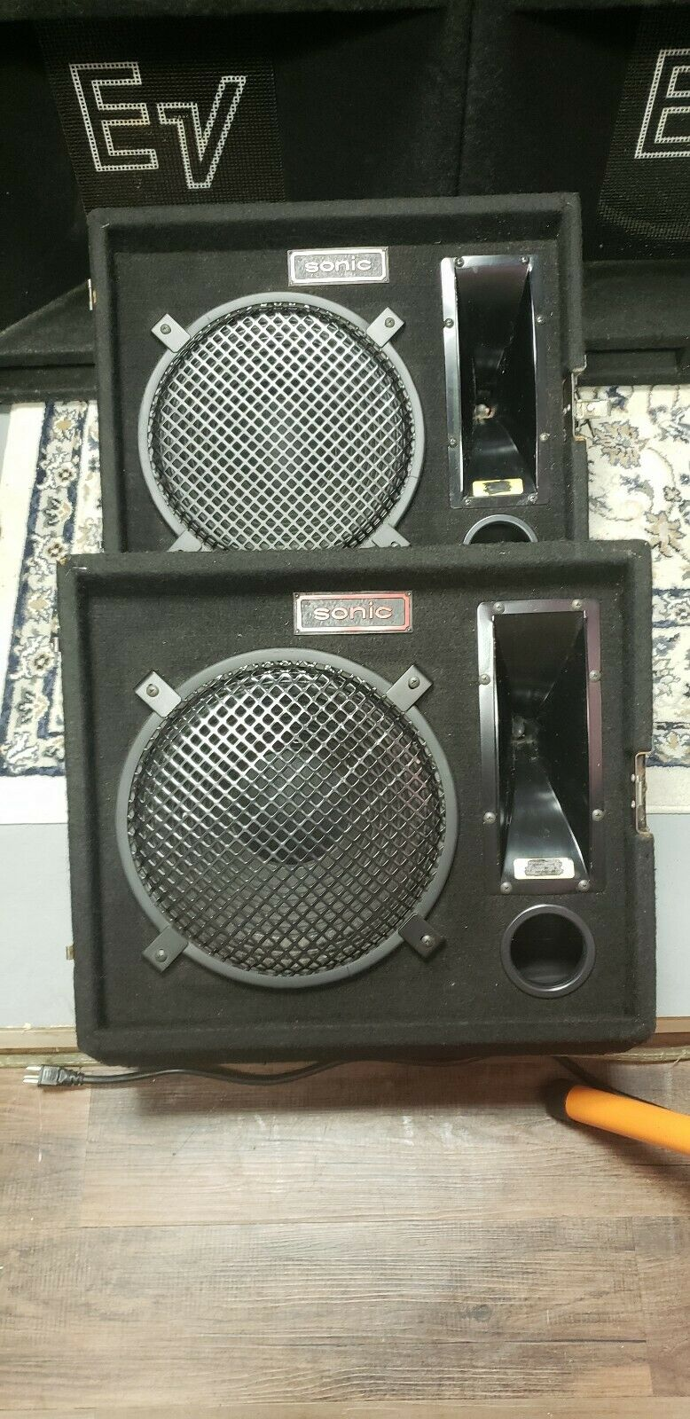 Sonic M112h Stage Monitors, locking together for easy storage.