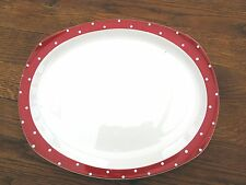 A large platter in Red Domino by Jessie Tait for Midwinter