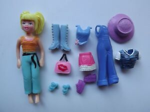 Mattel-Polly-Pocket-Doll-With-3-Outfits-and-Accessories-3