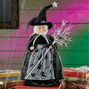 Spooky-Witch-Dressed-In-Black-Dress-with-Broom-Halloween-Tabletop-Decoration