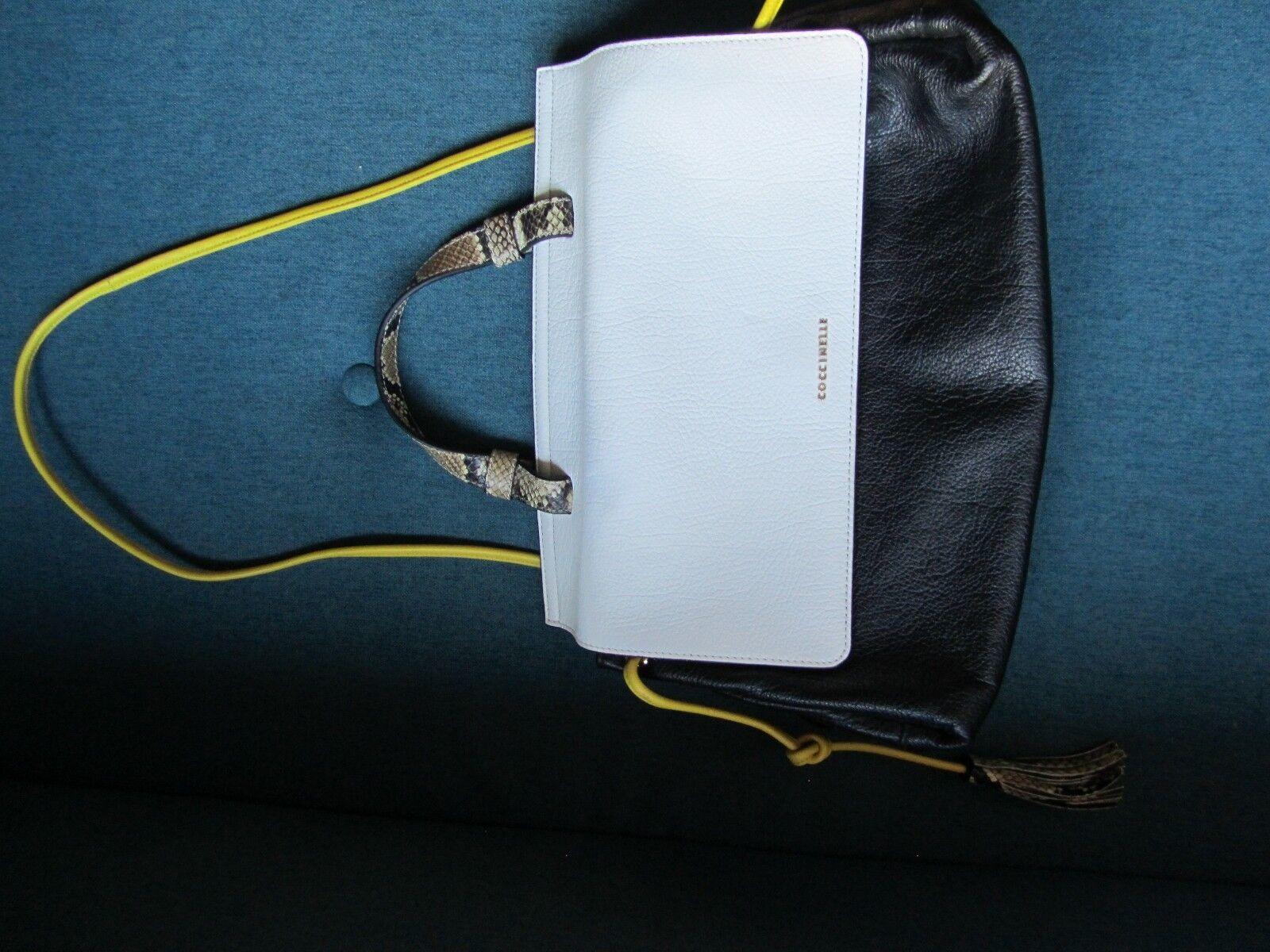 Coccinelle Handtasche schwarz weiß weiß weiß mit gelben und