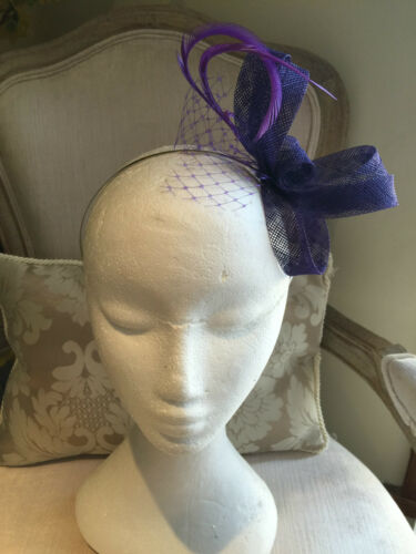 Gorgeous purple fascinator with loops, netting and feathers on a metal headband!