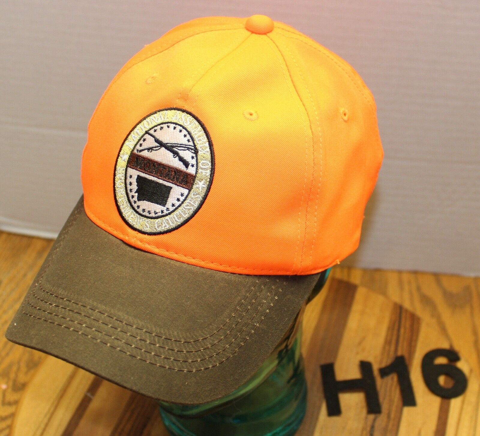 NWOT ASSEMBLY MONTANA NATIONAL ASSEMBLY NWOT OF SPORTSMEN'S CAUCUSES HAT ORANGE/BROWN H16 37b79c