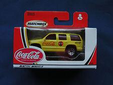 Matchbox Mattel Wheels 2002 Chevrolet Tahoe yellow logos on side of car #92353