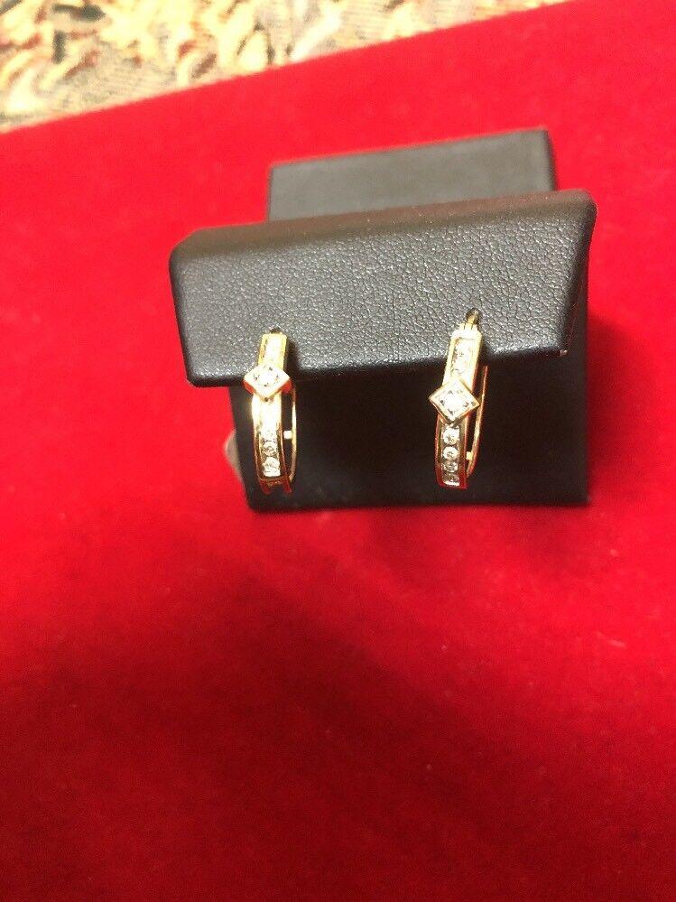 14k. Yelow gold Laddies Diamond Earrings