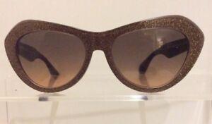 ecda7da9b274 Image is loading Miu-Miu-Cat-Eye-Gold-Glitter-Sunglasses