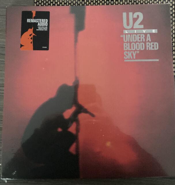 "LP U2 ""UNDER A BLOOD RED SKY(LP- REMASTERED)"". Neuf"