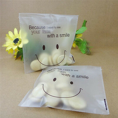 Cute 100Pcs Smile Self-Adhesive Cookie Candy Biscuit Wrapping Party Seal Bag