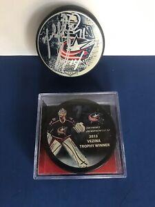 Columbus-Blue-Jackets-NHL-Hockey-Autographed-Puck-and-Bobrovsky-Vezina-Puck