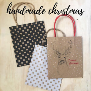 x10-SMALL-CHRISTMAS-PAPER-BAGS-with-carry-handle-choose-design-stag-or-polka