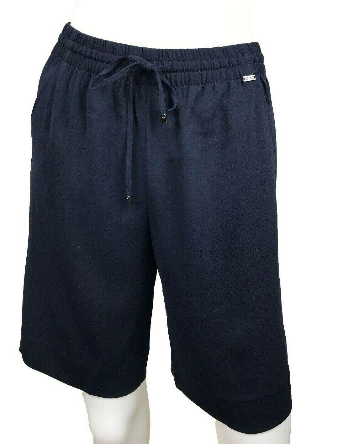 New w Tags  St. John Shorts. Navy bluee. Size Petite. Drawstring.