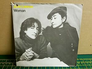 john lennon woman single vinyl - woman is the nigger of the world during john lennon's early solo years ripped from my virgin vinyl.