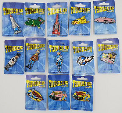 SET OF 11 BADGES MADE BY DUFORT /& SONS LTD THUNDERBIRDS