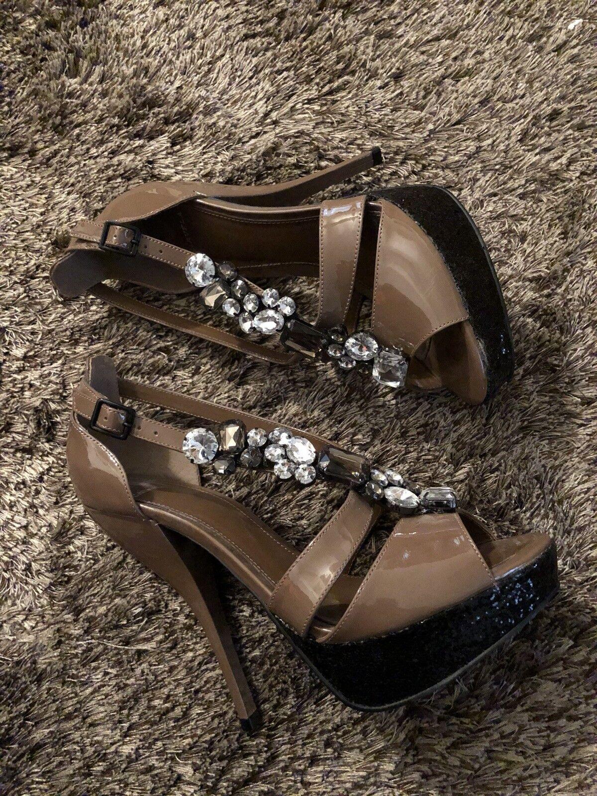 Carvela patent leather and embellished crystal platform heels. Size 40/10US.