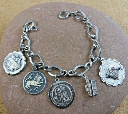 432 Vintage 7 Charms Pewter on a Stainless Steel Charm Bracelet