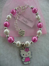 Childs pink white and silver beaded bracelet with hello kitty charm