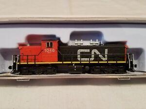 N-SCALE-RAPIDO-TRAINS-70018-CN-GMD-1-BLACK-amp-RED-SCHEME-1046-NEW