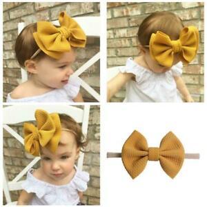 Baby-Maedchen-zarten-Bogen-Knoten-Stirnband-Nylon-Haarband-Stretch-Haarschmuck
