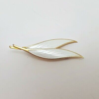 Mid-century Modernist Thune gold washed Sterling silver and white enamel leaf brooch.