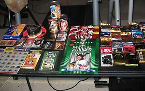 "Sports Collectible ""Grab box"" includes: cards in a can, cards, stickers, pins"