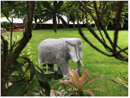 Solid pink granite elephant statue (matching pair if two ordered)