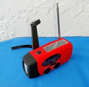Emergency Solar Hand Crank Flashlight Weather Radio. USB Charging, AM/FM/WB
