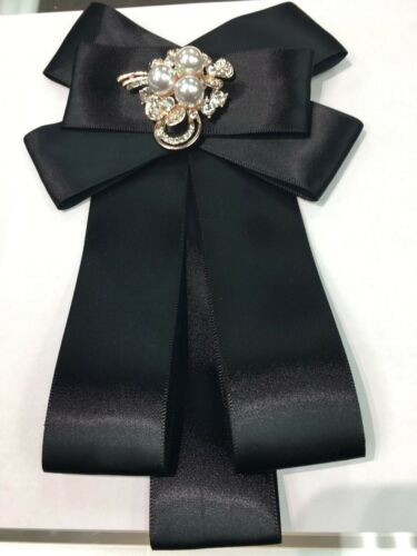 black bow with pearl and gold embellishment