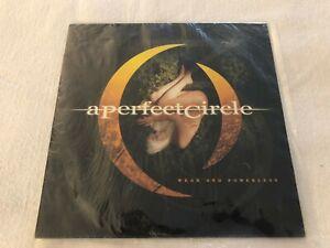 "A Perfect Circle ""Weak And Powerless"" (Vinyl, 7"", 45 RPM, Single, Orange)"