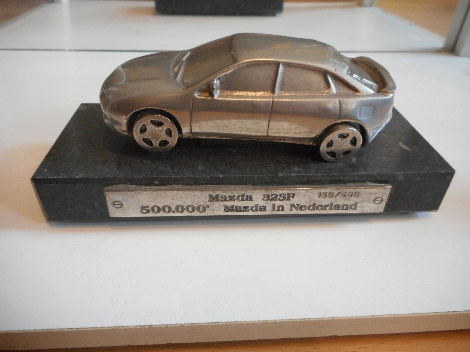 Dealer Gift Metal Mazda 323f  500.000 Mazda in Nederland  (Only 500 Made)