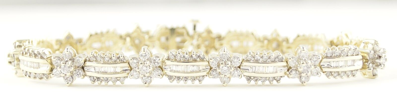 14k Yellow gold Baguette and Round Flower Ladies Bracelet