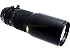 Nikon AI, Tele Tokina 400mm. f5,6, paraluce integrato, utilizzabile su digitali.