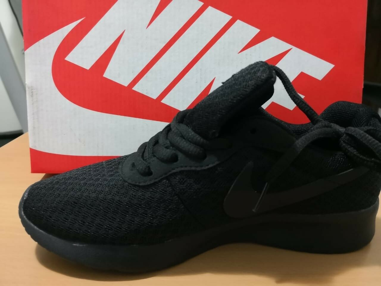 Nike tanjun black 2 sizes available, NEW IN BOX    LAST PIECES