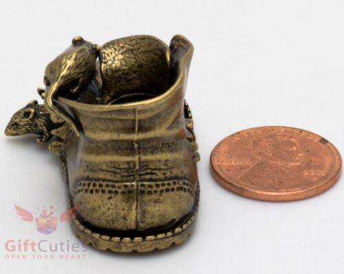 Solid Brass Figurine of torn by rats  vintage old shoe boot talisman IronWork