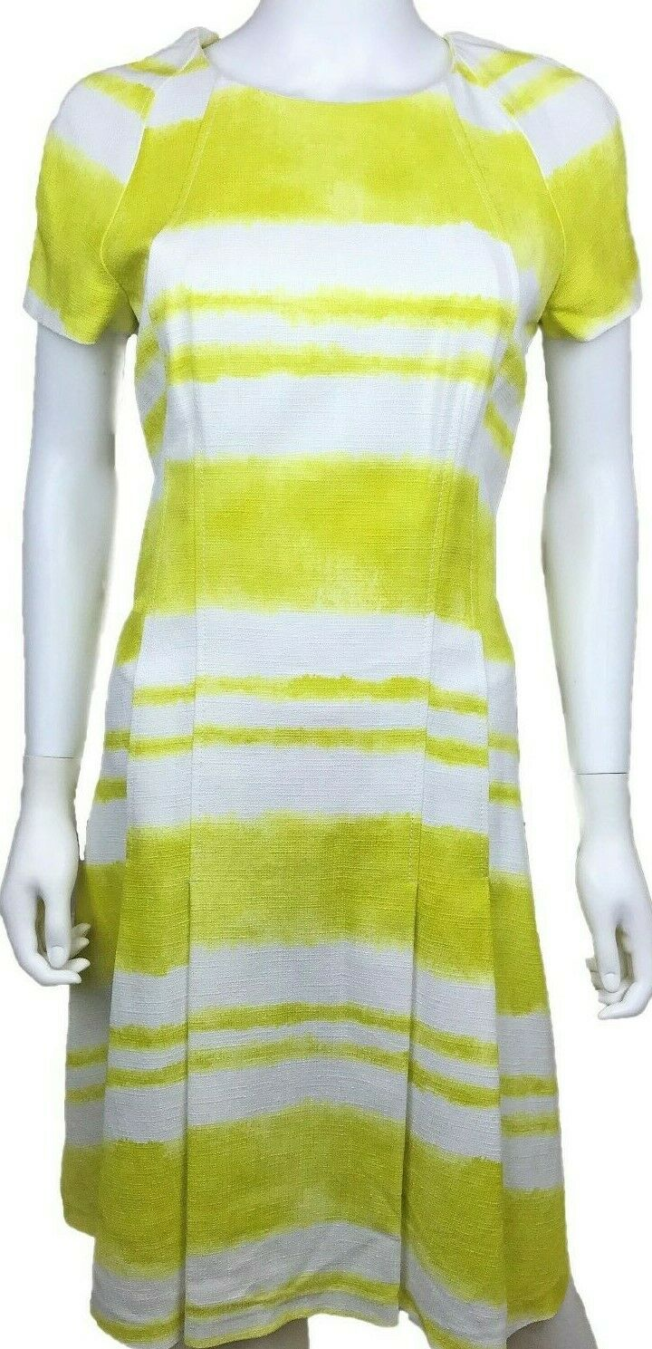 New w tag,300. CAROLINA HERRERA dress. Size 8. Yellow White Stripes. 76% off