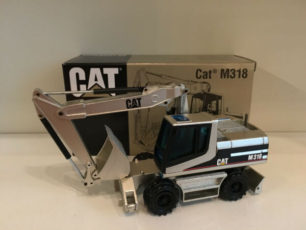 100% Vero Caterpillar M 318 Escavatore Mobile Argento Di Nzg 405 1:50 Ovp Acquista Ora