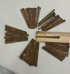 50 Antique 2 1/2 inch, square cut nails hand made unused, straight but rusty.