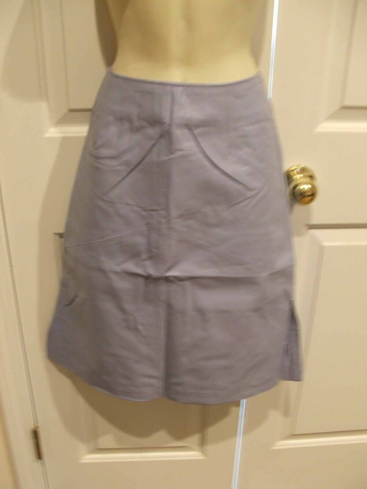 New in pkg   149 purple  fully lined leather  SKIRT size 10