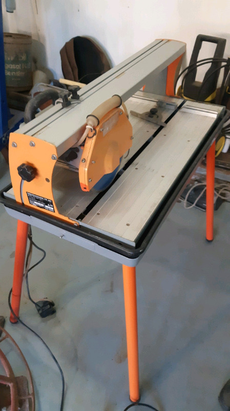 Tile cutter with water pump and stand