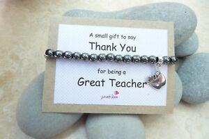 Teacher-Gift-bracelet-Hematite-with-apple-charm-stretchy-amp-organza-bag-grey