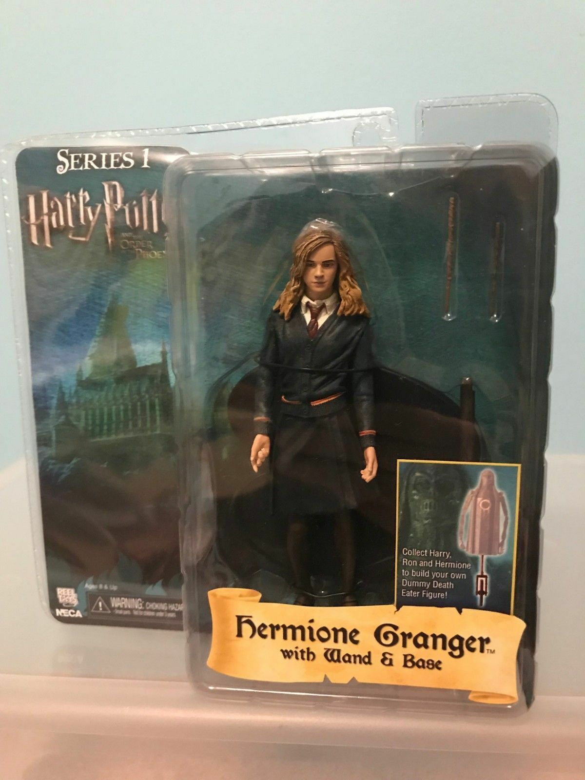 Harry Potter de la serie 1 Hermione Granger, la rara Fénix.