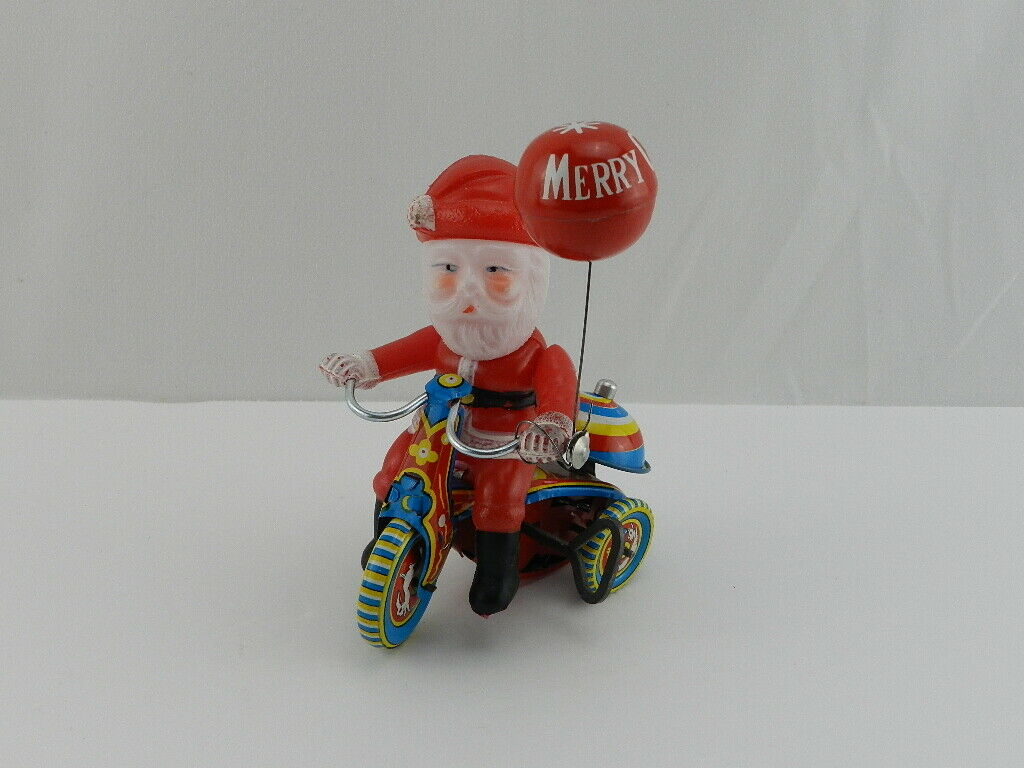 Vintage Suzuki Wind Up Litografía Celuloide Santa En Triciclo Juguete De Estaño Hecho en Japón