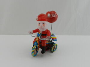 Vintage-SUZUKI-Wind-Up-Litho-Tin-Toy-Celluloid-Santa-On-Tricycle-Made-in-Japan