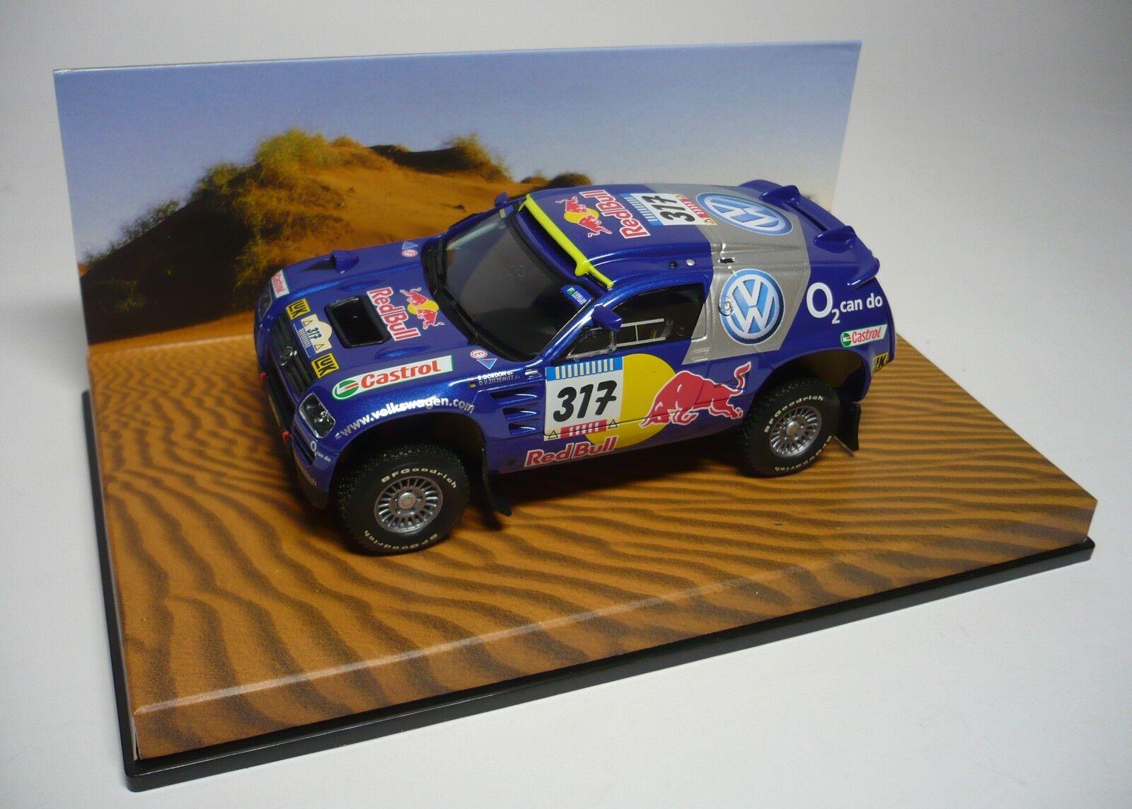 1 VW RACE TOUAREG  317 PARIS DAKAR 2005 1 43 MINICHAMPS