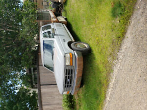 1993 ford one ton with flatdeck automatic.